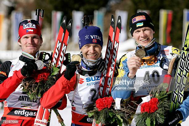 Michal Slesingr of the Czech Republic second place Ole Einar Bjoerndalen of Norway first place and Andriy Deryzemlya of the Ukraine third place...