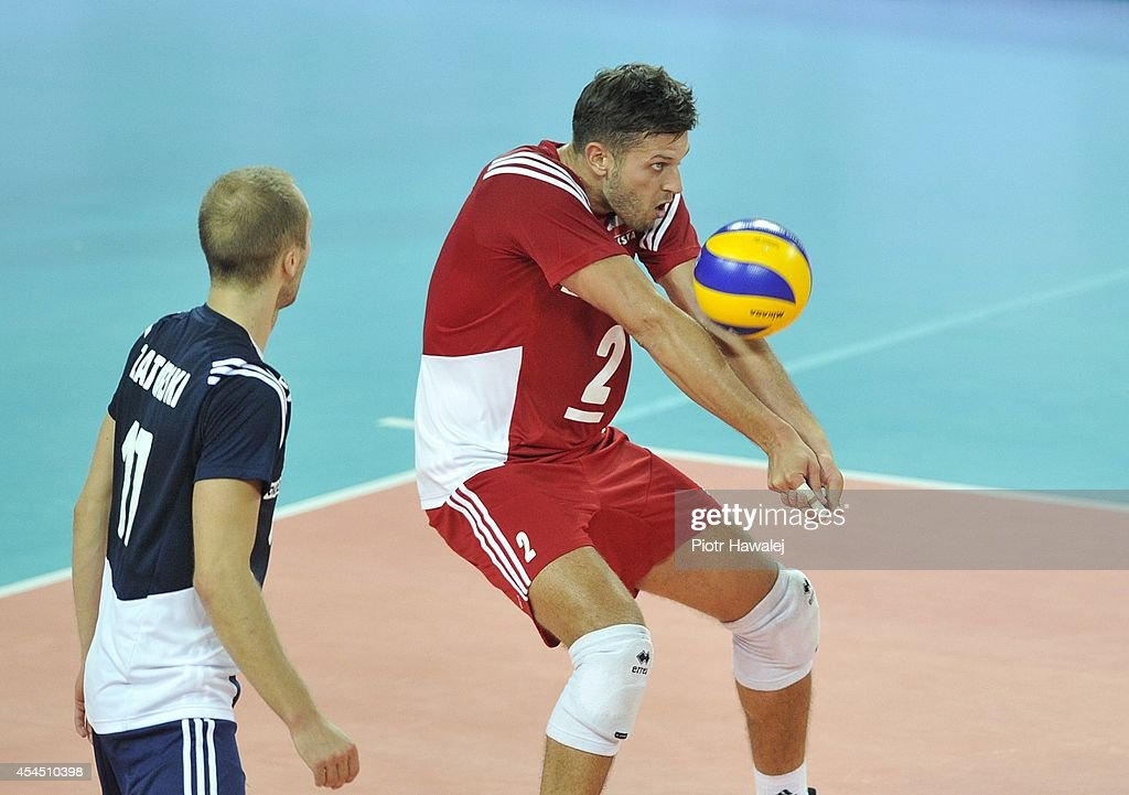 Michal Winiarski of poland receives the ball during the FIVB World Championships match between Australia and Poland on September 2, 2014 in Wroclaw, Poland.