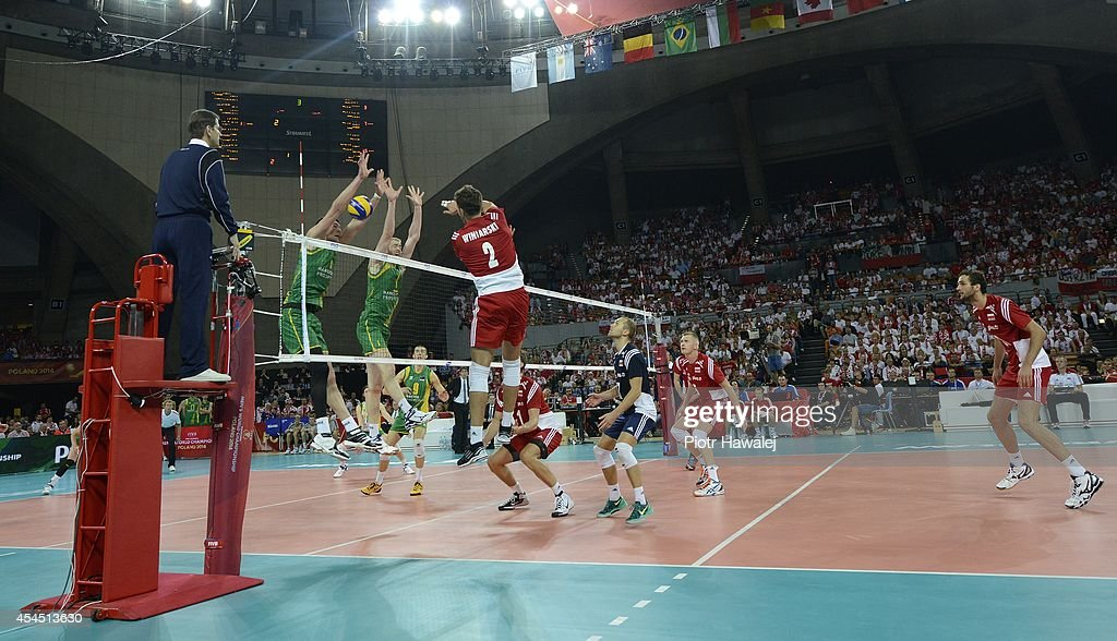 Michal Winiarski of Poland spikes the ball during the FIVB World Championships match between Australia and Poland on September 2, 2014 in Wroclaw, Poland.