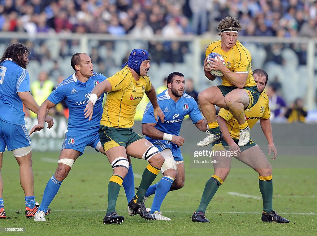 Michale Hooper of Australia (R) holds the ball during the international rugby test match between Italy and Australia at Artemio Franchi on November 24, 2012 in Florence, Italy.