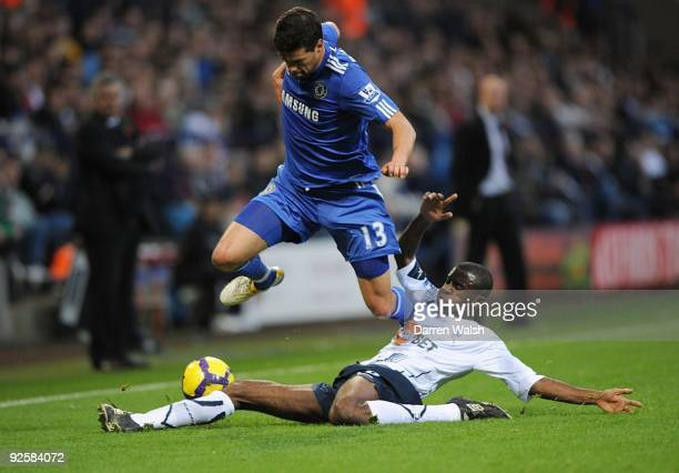 Micheal Ballack of Chelsea is Tacked by Fabrice Muamba of Bolton during the Barclays Premier League match between Bolton and Chelsea at the Reebok...