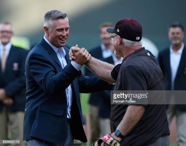 Micheal Cuddyer shakes hands with former manager of the Minnesota Twins and current bench coach Ron Gardenhire of the Arizona Diamondbacks after a...