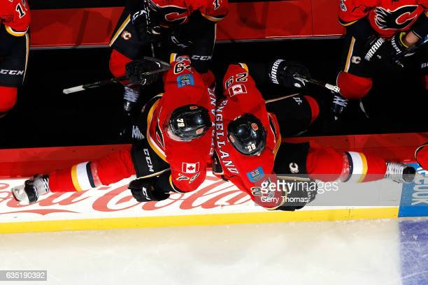 Micheal Ferland and Deryk Engelland of the Calgary Flames jump over the boards for a shift against the Arizona Coyotes during an NHL game on February...