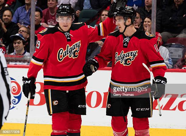 Micheal Ferland and Mikael Backlund of the Calgary Flames celebrate after a goal against the Toronto Maple Leafs at Scotiabank Saddledome on February...