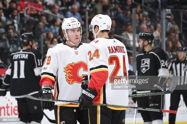 Micheal Ferland and Travis Hamonic of the Calgary Flames converse during a game against the Los Angeles Kings at STAPLES Center on October 11 2017 in...
