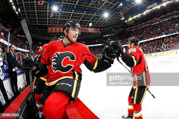 Micheal Ferland Kris Versteeg and teammates of the Calgary Flames celebrate a goal against the Toronto Maple Leafs during an NHL game on November 30...
