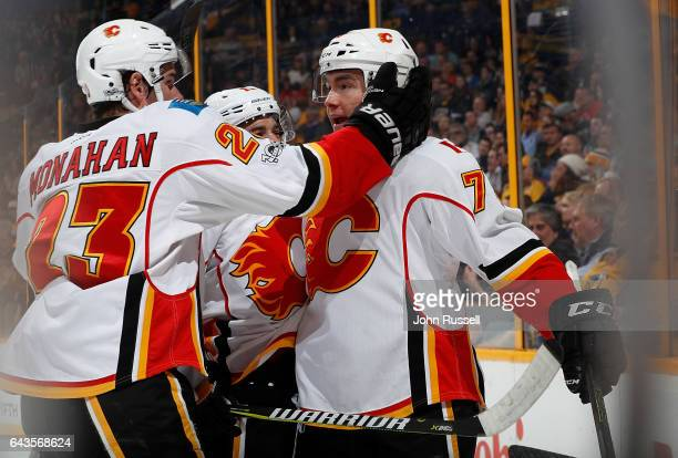 Micheal Ferland of the Calgary Flames celebrates his goal with Sean Monahan against the Nashville Predators during an NHL game at Bridgestone Arena...