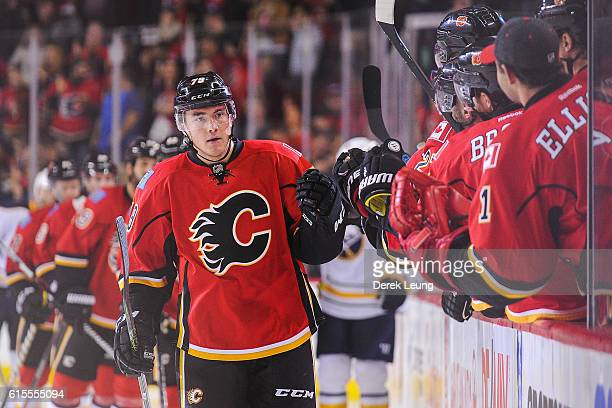 Micheal Ferland of the Calgary Flames celebrates with the bench after scoring his team's second goal against the Buffalo Sabres during an NHL game at...