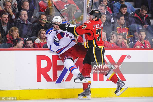 Micheal Ferland of the Calgary Flames checks Dylan McIlrath of the New York Rangers during an NHL game at Scotiabank Saddledome on December 12 2015...