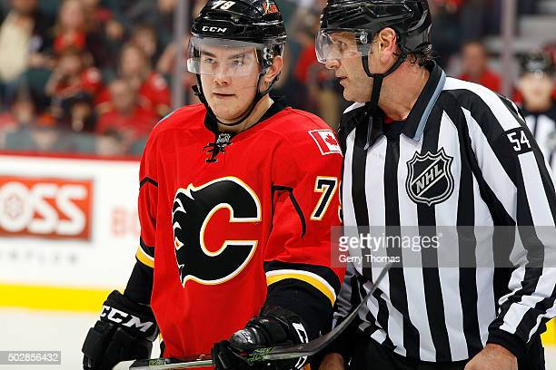 Micheal Ferland of the Calgary Flames has a discussion with a referee during an NHL game against the Anaheim Ducks at Scotiabank Saddledome on...