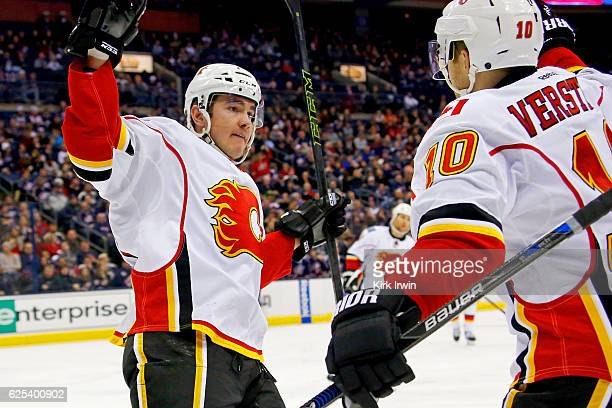 Micheal Ferland of the Calgary Flames is congratulated by Kris Versteeg of the Calgary Flames after scoring a goal during the third period of the...