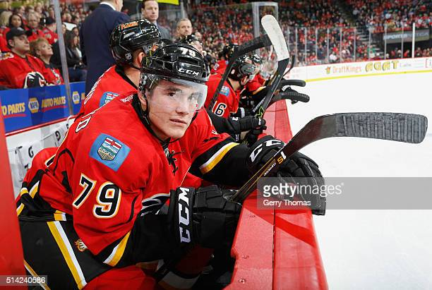 Micheal Ferland of the Calgary Flames looks on from the bench against the San Jose Sharks at Scotiabank Saddledome on March 7 2016 in Calgary Alberta...