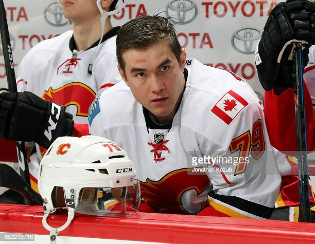 Micheal Ferland of the Calgary Flames looks on from the bench prior to puck drop against the Winnipeg Jets at the MTS Centre on March 11 2017 in...