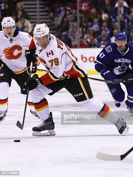 Micheal Ferland of the Calgary Flames plays the puck against the Vancouver Canucks during their NHL game at Rogers Arena on October 15 2016 in...