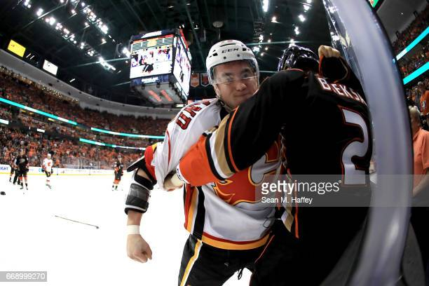 Micheal Ferland of the Calgary Flames punches Kevin Bieksa of the Anaheim Ducks during the second period of Game Two of the Western Conference First...