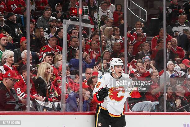 Micheal Ferland of the Calgary Flames reacts after the Flames scored in the first period against the Chicago Blackhawks at the United Center on...