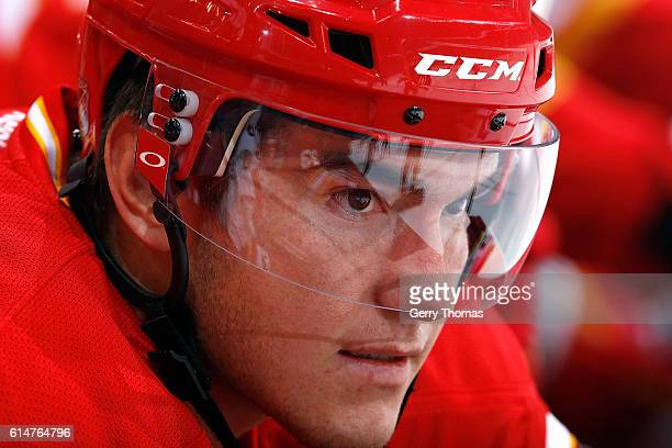 Micheal Ferland of the Calgary Flames sits on the bench against the Edmonton Oilers during an NHL game on October 14 2016 at the Scotiabank...