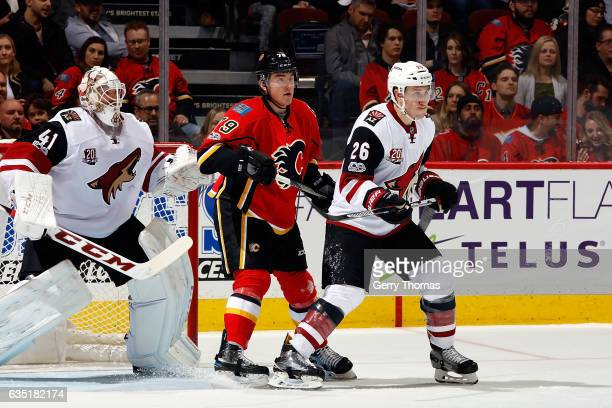 Micheal Ferland of the Calgary Flames skates against Michael Stone of the Arizona Coyotes during an NHL game on February 13 2017 at the Scotiabank...