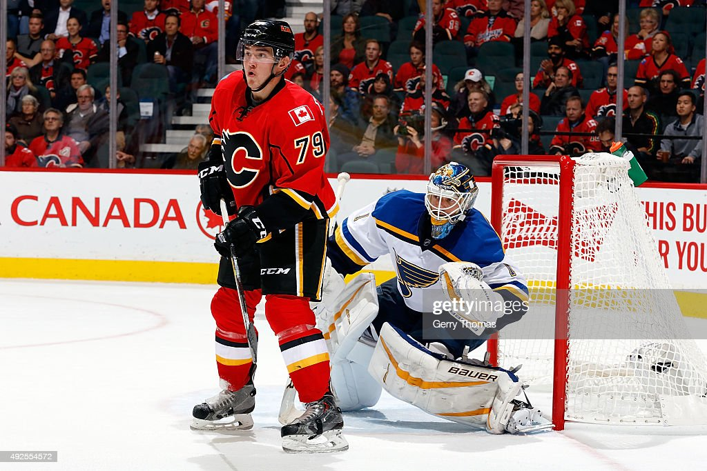 Micheal Ferland #79 of the Calgary Flames skates in front of Brian Elliot #1 of the St. Louis Blues during an NHL game at Scotiabank Saddledome on October 13, 2015 in Calgary, Alberta, Canada.