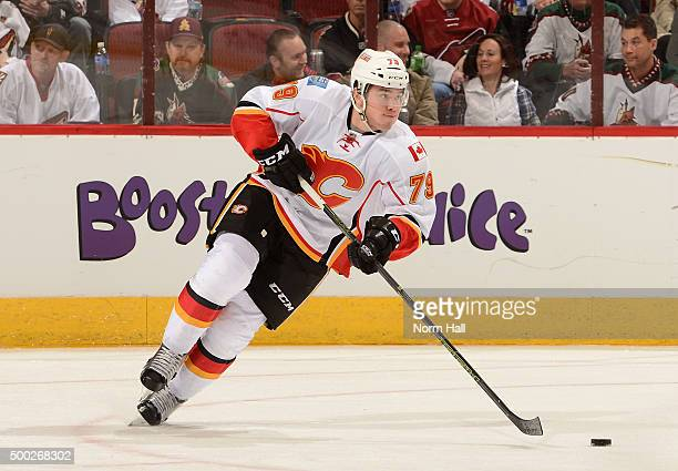 Micheal Ferland of the Calgary Flames skates the puck up ice against the Arizona Coyotes at Gila River Arena on November 27 2015 in Glendale Arizona
