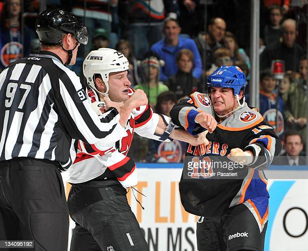 Micheal Haley of the New York Islanders and Cam Janssen of the New Jersey Devils fight during the first period at Nassau Veterans Memorial Coliseum...