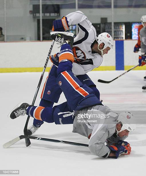 Micheal Haley of the New York Islanders is upended by Rob Schremp during a training camp session at Iceworks on September 19 2010 in Syosset New York