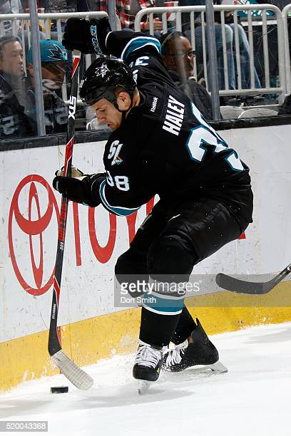 Micheal Haley of the San Jose Sharks controls the puck behind the net during a NHL game at the SAP Center at San Jose on April 7 2016 in San Jose...