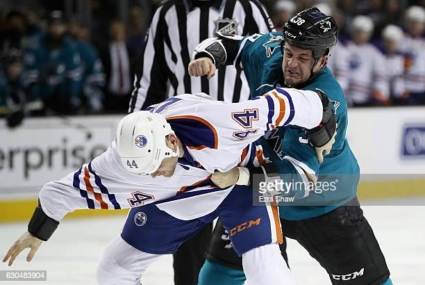 Micheal Haley of the San Jose Sharks fights with Zack Kassian of the Edmonton Oilers at SAP Center on December 23 2016 in San Jose California