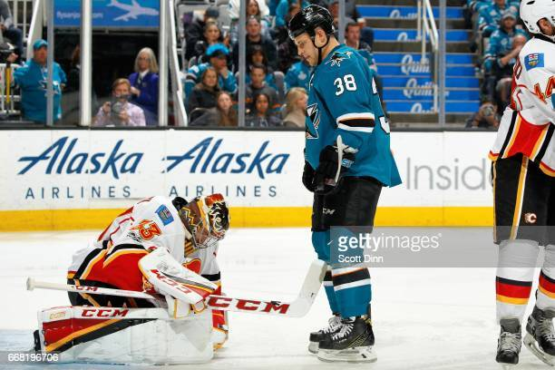 Micheal Haley of the San Jose Sharks looks after David Rittich of the Calgary Flames makes a save at SAP Center at San Jose on April 8 2017 in San...