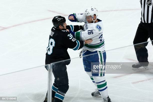 Micheal Haley of the San Jose Sharks scuffles with Joseph Cramarossa of the Vancouver Canucks during a NHL game at SAP Center at San Jose on March 2...