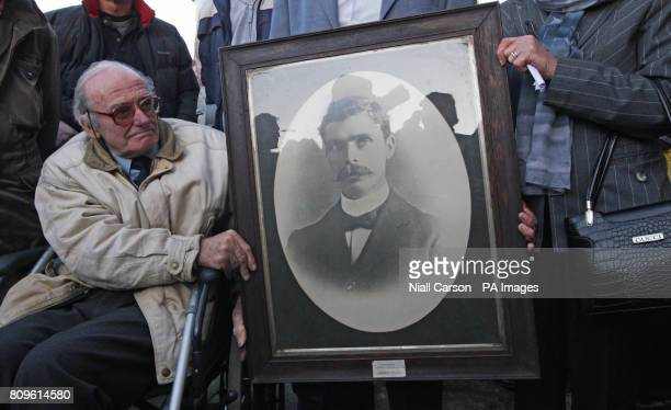 Micheal Mallin holds a photo of his great grandfather executed 1916 leader Michael Mallin at the unveiling of a plaque on house of executed 1916...