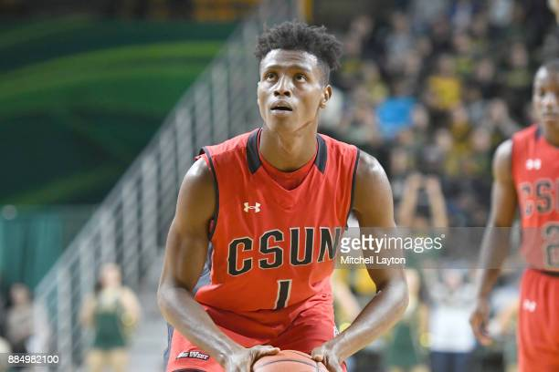 Micheal Warren of the Cal State Northridge Matadors takes a foul shot during a college basketball tournament against the George Mason Patriots at the...