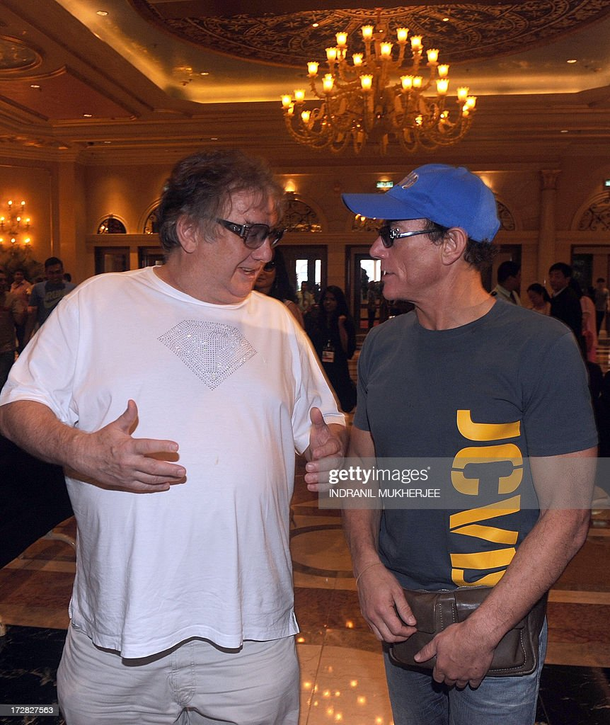 Michel Adam, Fashion TV (FTV) President and Founder (L) speaks with Belgian born Hollywood action star actor Jean-Claude Van Damme as he arrives for the 14th International Indian Film Academy (IIFA) at The Venetian hotel in Macau on July 5, 2013. The annual IIFA Awards, India's Hindi language film industry, Bollywood's glitziest awards ceremony, which have been held overseas for the last 13 years, is one of the world's most-watched annual entertainment ceremonies, broadcast to nearly 500 million viewers in 110 countries. AFP PHOTO/Indranil MUKHERJEE