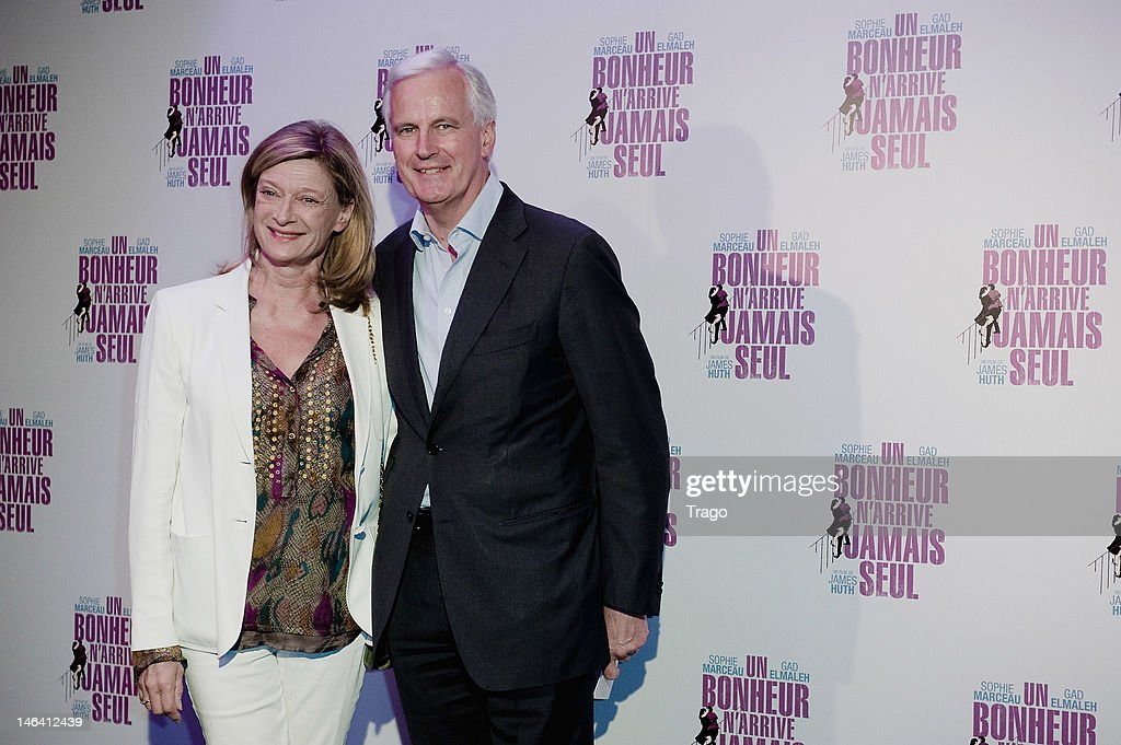 <a gi-track='captionPersonalityLinkClicked' href=/galleries/search?phrase=Michel+Barnier&family=editorial&specificpeople=220639 ng-click='$event.stopPropagation()'>Michel Barnier</a> (R) and her wife attend 'Un Bonheur N'Arrive Jamais Seul' Premiere at Cinema Gaumont Marignan on June 15, 2012 in Paris, France.