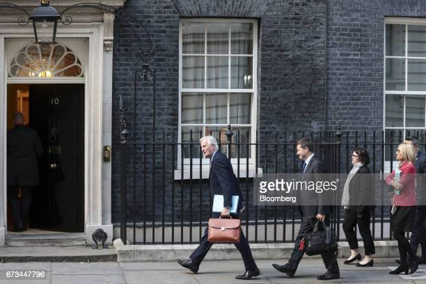 Michel Barnier chief Brexit negotiator for the European Union center arrives in Downing Street in London UK on Wednesday April 26 2017 UK Prime...
