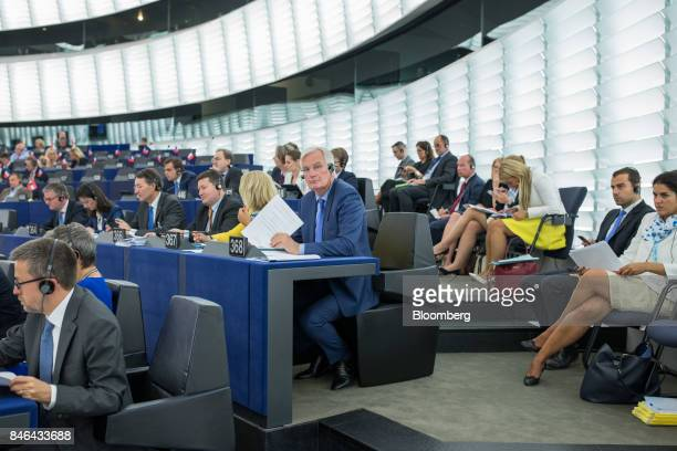 Michel Barnier chief negotiator for the European Union center attends the State of the Union speech at the European Parliament in Strasbourg France...