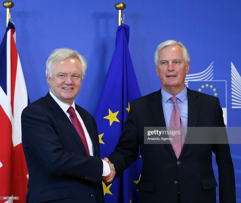 Michel Barnier (R), chief negotiator for the European Union meets Secretary of State for Exiting the European Union David Davis, ahead of the start of Brexit negotiations in Brussels, Belgium, on Monday, June 19, 2017.