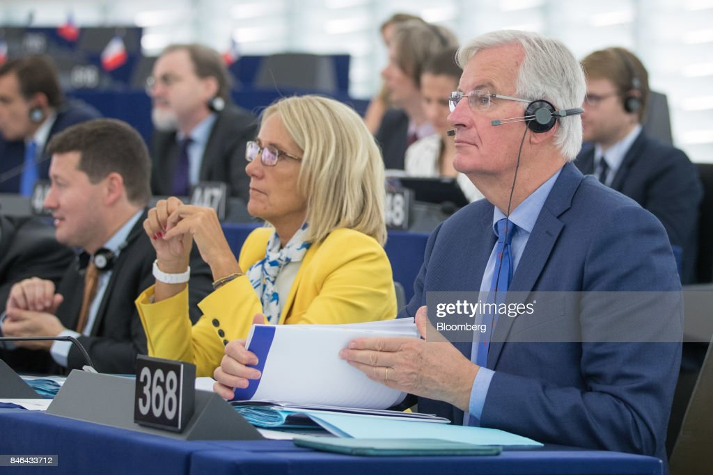 Michel Barnier, chief negotiator for the European Union (EU), right, attends the State of the Union speech at the European Parliament in Strasbourg, France, on Wednesday, Sept. 13, 2017. In a sign of the EUs renewed confidence, European Commission President Jean-Claude Juncker will push for free-trade pacts withAustralia and New Zealandat a time when the U.S. is turning inward, along with a bloc-wide system for screening foreign takeovers and deeper euro-area banking integration. Photographer: Jasper Juinen/Bloomberg via Getty Images
