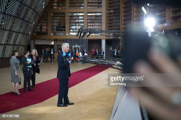 Michel Barnier chief negotiator for the European Union talks to members of the media as he arrives for a European Union leaders emergency Brexit...