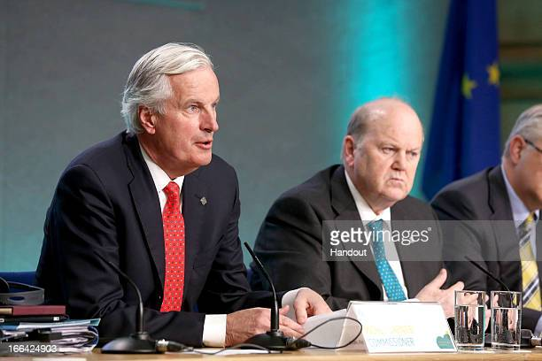 Michel Barnier Commisioner for Internal Market and Services and Minister for Finance Michael Noonan attend a press conference following the Eurogroup...