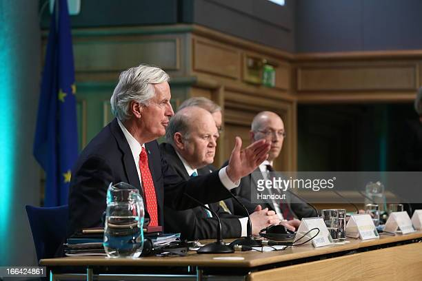 Michel Barnier Commisioner for Internal Market and Services Minister for Finance Michael Noonan and Olli Rehn the European Commision Vice President...