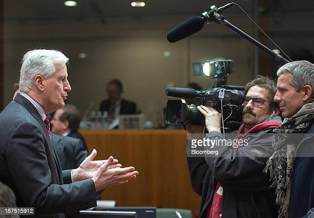 Michel Barnier European Commissioner for Financial Services left speaks during a television interview at a meeting of European Union finance...