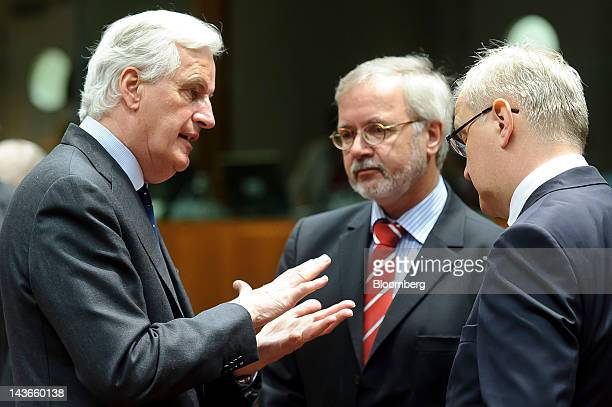 Michel Barnier European Commissioner for Internal Market and Financial Services left gestures as he speaks to Werner Hoyer president of the European...