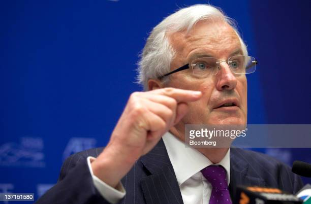 Michel Barnier European Commissioner for Internal Market and Financial Services gestures while speaking at a news conference at the Asian Financial...