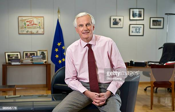 Michel Barnier European Union internal market commissioner poses for a photograph in his office at the EU commission headquarters in Brussels Belgium...