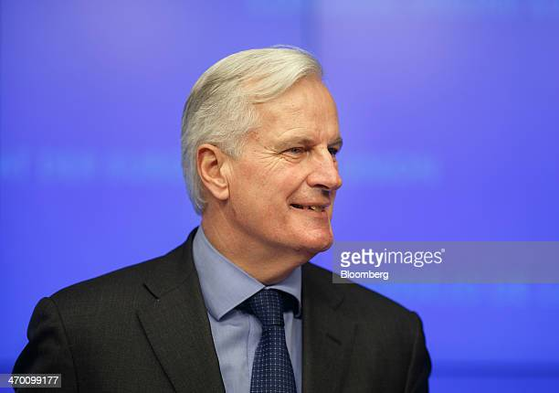Michel Barnier financial services commissioner for the European Union reacts during a news conference after a meeting of EU finance ministers at the...