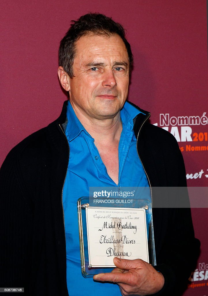 Michel Barthelemy poses with his nomination certificate for Best Set Design during the nominations event for the 2016 César film awards, on February 6, 2016 in Paris. The 41st Ceremony for the Cesar film award, considered as the highest film honour in France, will take place on February 26, 2016. / AFP / FRANCOIS GUILLOT