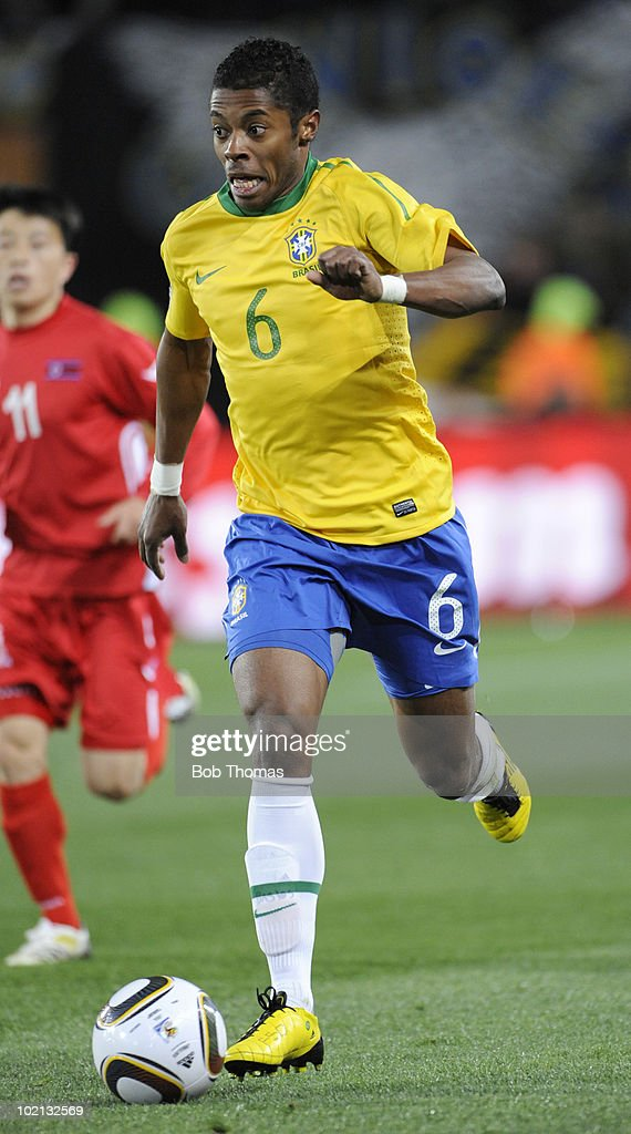 <a gi-track='captionPersonalityLinkClicked' href=/galleries/search?phrase=Michel+Bastos&family=editorial&specificpeople=1549621 ng-click='$event.stopPropagation()'>Michel Bastos</a> of Brazil moves the ball during the 2010 FIFA World Cup South Africa Group G match between Brazil and North Korea at Ellis Park Stadium on June 15, 2010 in Johannesburg, South Africa. Brazil won the match 2-1. (Photo by Bob Thomas/Getty Images).