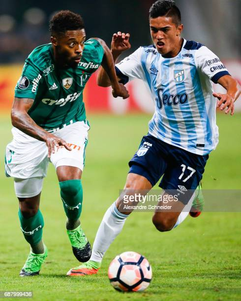 Michel Bastos of Palmeiras of Brazil and Tomas Cuello of Atletico Tucuman in action during the match between Palmeiras and Atletico Tucuman for the...