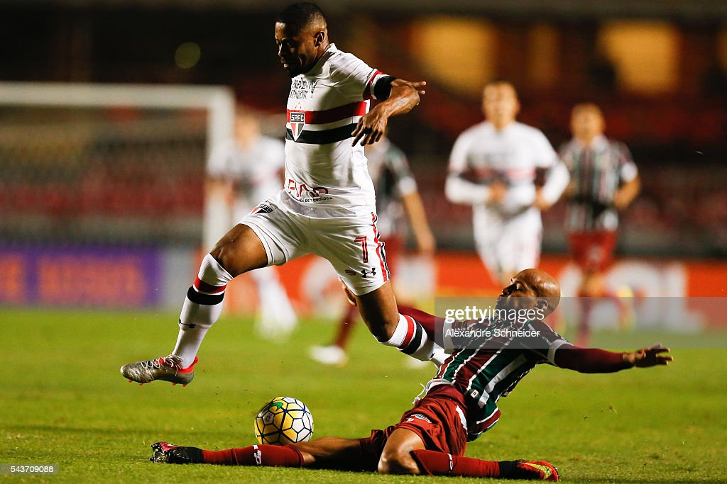 <a gi-track='captionPersonalityLinkClicked' href=/galleries/search?phrase=Michel+Bastos&family=editorial&specificpeople=1549621 ng-click='$event.stopPropagation()'>Michel Bastos</a> (L) of Sao Paulo and Wellington Silva of Fluminense in action during the match between Sao Paulo and Fluminense for the Brazilian Series A 2016 at Morumbi stadium on June 29, 2016 in Sao Paulo, Brazil.